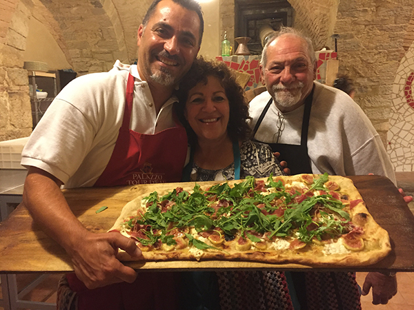 A pic of a pizza making class